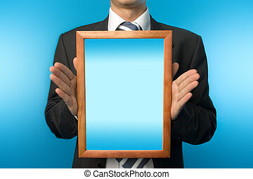 Businessman with wooden frame - Businessman making a...