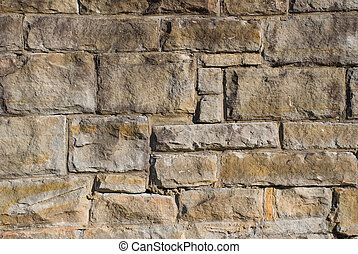 an old stone wall - a close up of an old stone wall made...