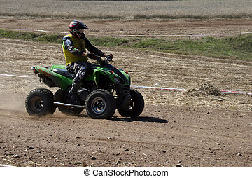 Quad race series - Proffesional quad biker during the golden...