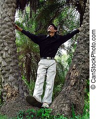 Freedom - A happy Indian young man enjoying freedom outdoors