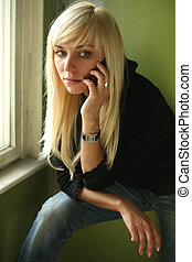 Girl with the phone - The nice blonde with the phone on a...