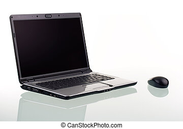 Laptop Computer - A modern laptop computer and wireless...