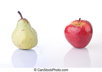 Difference - Red apple and Pear, with water drops, on white...