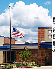 building with flag half mast - a flag flying half mast over...