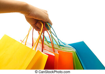 Shopping bags - A woman hand carrying a bunch of colorful...
