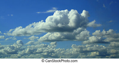 clouds over the blue sky - a beautiful summer day and clouds...