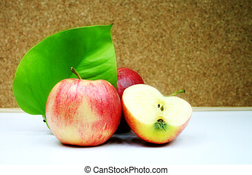 healthy living - three red apple and a green leaf - health,...