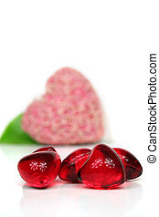 Love - some red hearts against white background - valentine...