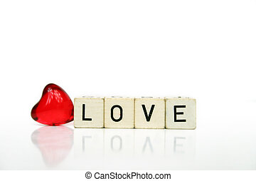 Love - a red heart and cubes with letters on a white...