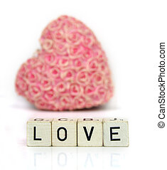 Love - a red heart with flowers and cubes with letters on a...