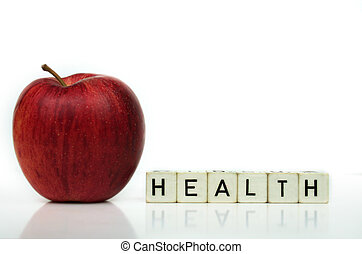 healthy living - red apple and cubes with letters in front...