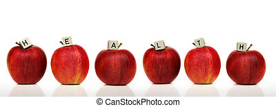 healthy living - six red apple and cubes with letters in...