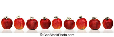 healthy living - a row of red apples with cubes of letters...