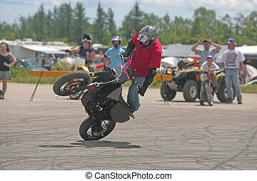 doing a stunt - moto cross rider at elliot lake