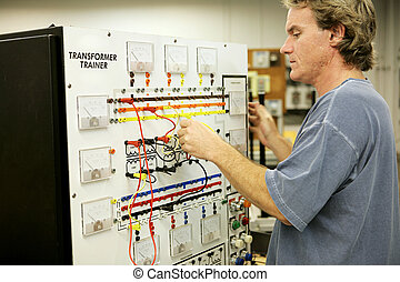 Electronics Training - An adult education student learning...