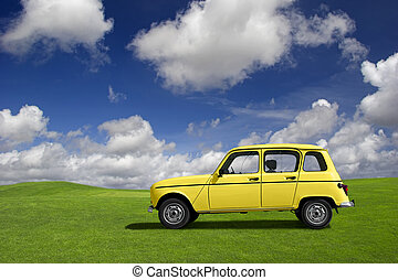 Yellow funny car - Yellow classic car in a green meadow