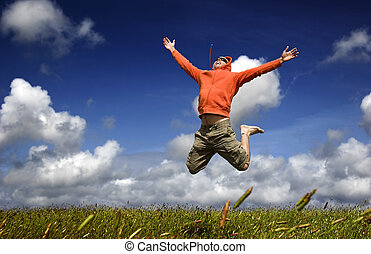 High Jump - Man jumping on a green meadow with a beautiful...