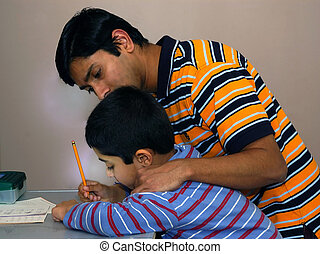 Coaching - A diligent father coaching and guiding his son