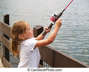 girl fishing - little girl fishing from the docks with a...