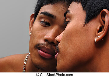 Gay kiss - Tanned Asian boy kissing his mirror image,...