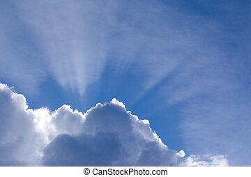 Sunburst - The sun bursts out behind a cloud formation, shot...