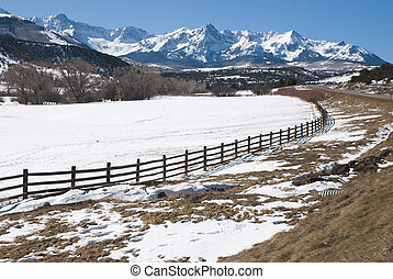 Snow on Dallas Divide - Snowy ranch with fence beside the...