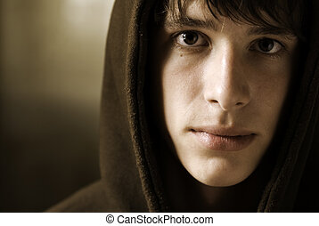 teen - young adult with hood, special toned photo fx, focus...