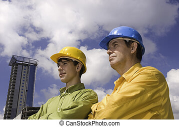 builders - wiseman and young adult on construction...