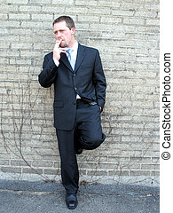 cigarette break - young business man taking a cigarette...