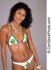 Sexy brazilian - Beautiful brazilian girl in bikini on grey...