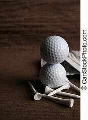 Stacked Golf Balls - Two Golf balls stacked onto one another...