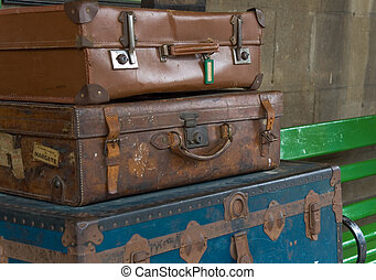 Travelling Suitcases - Stacked old suitcases on a train...