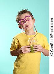 Fruitilicious - Enjoying a green health juice containing...