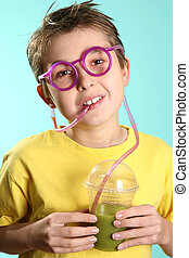 Boy with a healthy superjuice - A boy drinks a healthy juice...