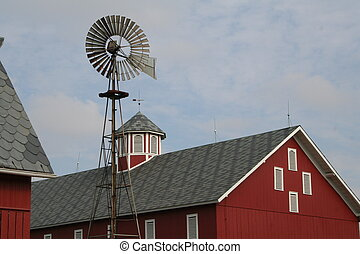 Barn with weather vane in the foreground