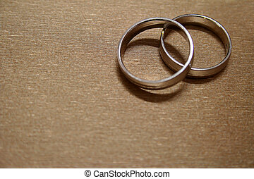 Wedding Rings - A pair of wedding rings against gold...
