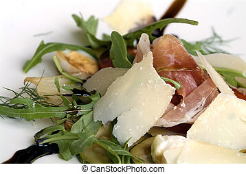 antipasti - decorated antipasti with ham and parmesan on...