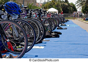 Triathlon competition - Group of Bikes\\\' wheels in a row...