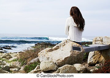 Lonely Girl - Great shot of a girl watching the waves.