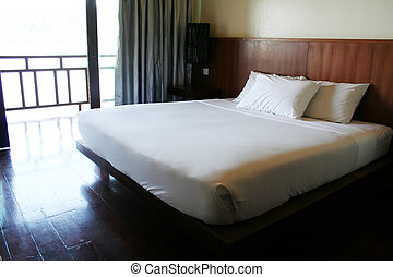 Resort bed - White double bed in a hotel resort