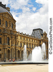 Louvre - Building of Louvre museum on summer day in Paris,...