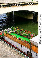 Houseboat in Paris - Charming houseboat with flowers docked...