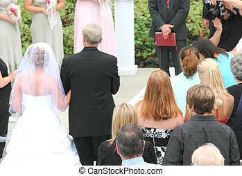 Wedding Ceremony - Father escorting his daughter to the...