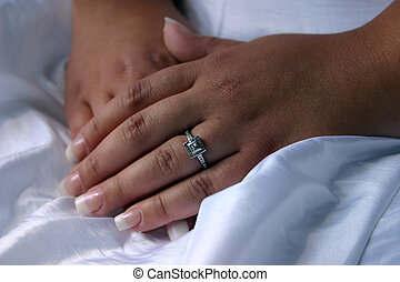 wedding hands - closeup of a bride\\\'s hands and engagement...