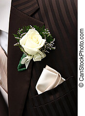 brown tux - A closeup of a dark brown tuxedo; lapel area....