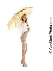 golden umbrella girl - lovely girl with golden umbrella over...