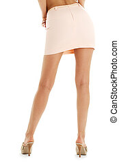 legs and back of lady in pink skirt