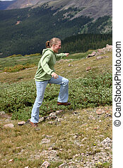 Mountain Girl - Beautiful young girl dressed in hoodie and...