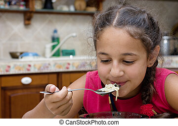 Girl eating soup - Coquettish girl eating soup