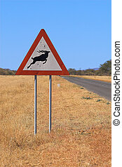Street sign showing a gazelle symbol. The picture was taken...